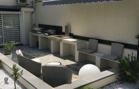 Terrasse avec pavés et jardin minéral